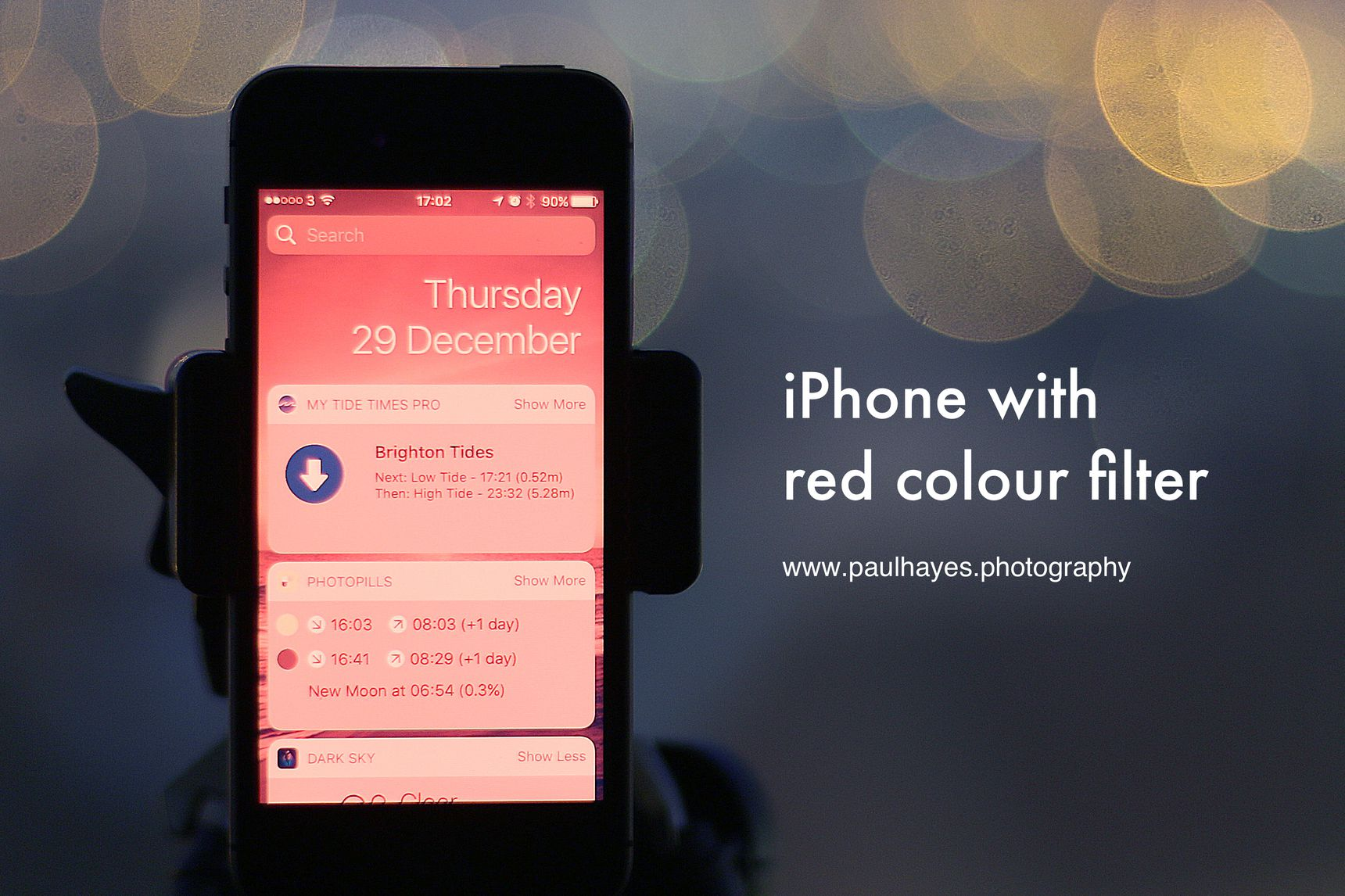 An iPhone with a red colour filter enabled