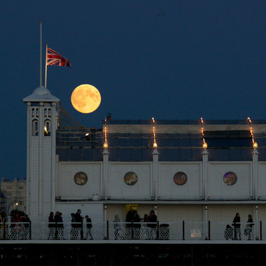 Supermoon rising over Brighton Pier